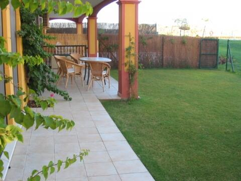 Garden with gate onto pool area