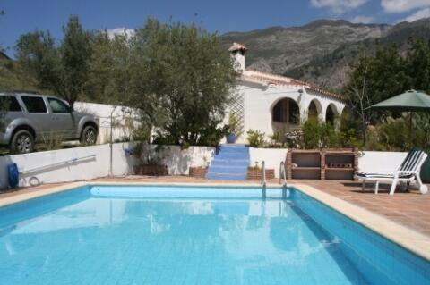pool, villa and backdrop of mountains