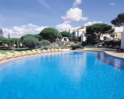 Large sunny pool with snack bar and free sunloungers
