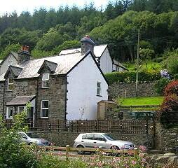 The cottage with Gwydyr Forest behind