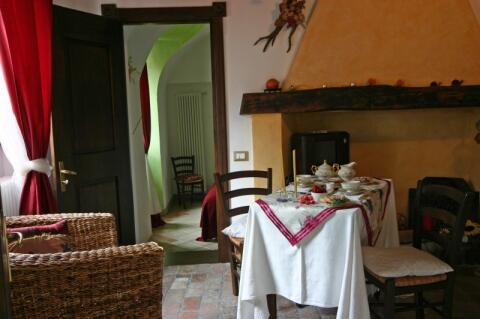 This is the oldest room in our house: its terracotta floor and its timber ceiling beams create the perfect ambiance for your relax. The antique wardrobe hosts a small library with touristic leaflets and information. Here you can listen to music or watching tv at your ease.