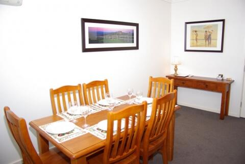 Dining setting for six people. This has been changed to a brushed chrome & glass table with leather chairs, as the apartment is redecorated in stages.