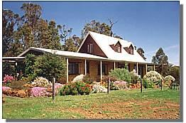 Unique, thermo-stable mudbrick home with lovely views to nearby hills and delightful gardens