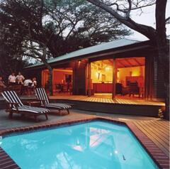 Property Photo: Main Lodge with lounge, dining, kitchen and pool deck