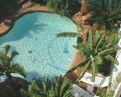 Property Photo: Aerial view of pool