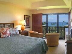 Property Photo: The large king bedroom opens to sweeping ocean views and has ensuite