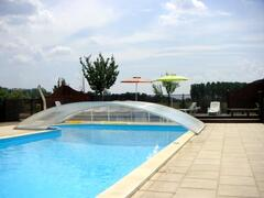 The heated swimming pool, 12m x 5m, with oxygen treated water, large sun deck and solar shower.