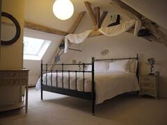 The Grange - main bedroom with King size bed