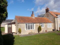 Property Photo: South facing across private garden