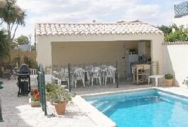 Property Photo: Heated pool and kitchen area