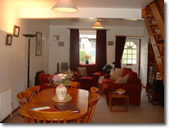 Property Photo: The lovely lounge at Stybarrow Cottage with traditional open fire