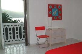 Living/dining area with balcony