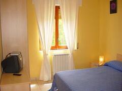 Property Photo: Double bedroom with window