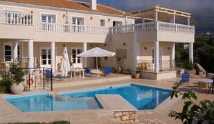 Property Photo: Large terrace surrounds the pools