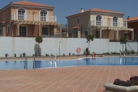 Private communal pool in landscaped gardens