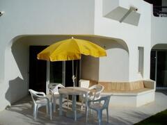 Property Photo: Patio overlooking pool area