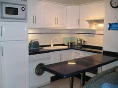 Brand New Blue and White Kitchen containing all modern amenities