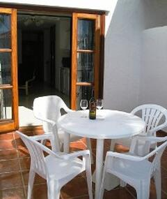 The private balcony has two sunbeds, plus a table with four chairs for Alfresco dining.