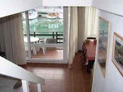 Property Photo: view on the living room, the loggia in front of the ships