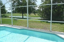 Property Photo: South facing pool with view of lake and 5th green