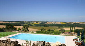 Property Photo: 12m x 6m swimming pool with panoramic views of the surrounding countryside
