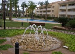 Property Photo: Fountain and pool area