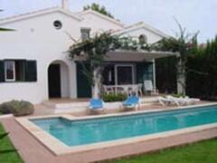 Property Photo: Entrance of the house with the Pool.