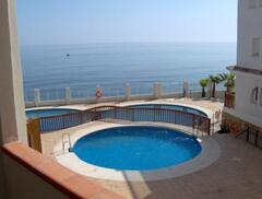 Property Photo: This is one of the swimming pools with its great sea views