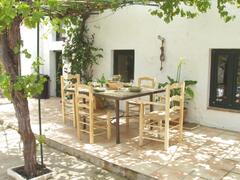 Vine-covered patio ideal for al fresco dining