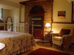 Master bedroom with King bed, fireplace, ensuite bath w Jacuzzi