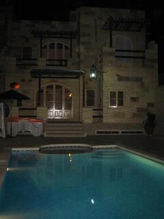 Property Photo: Pool area by night