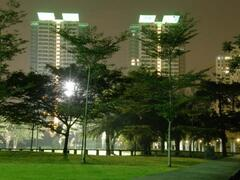 Property Photo: Night view of condo's from the park