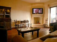 Property Photo: Living room with fireplace and dining table