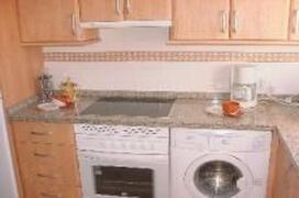 Kitchen: washing machine and dish washer