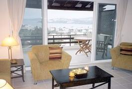 Property Photo: lounge and balcony with sea views