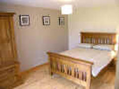 This photo shows one of the bedrooms of Cois Farraige Cottage.