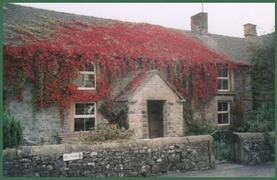 Property Photo: The front of Knowl Cottage in Autumn