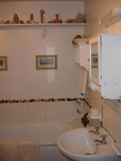Bathroom with shower cabinet