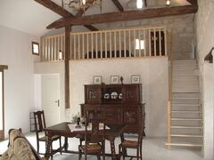 Fleur d'Acacia, spacious dining-room with wood-stove
