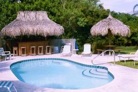 Property Photo: Beach Place pool and Tiki Bar