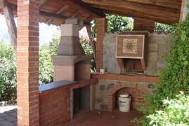 Barbecue corner with bread/pizza oven.....