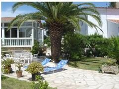 Property Photo: Garden with sunbeds