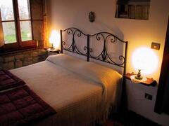 double bedroom with stone walls