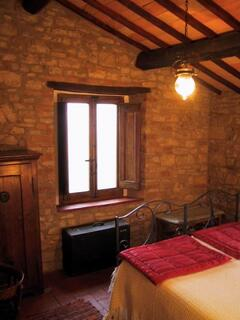 double bedroom with stone walls 2