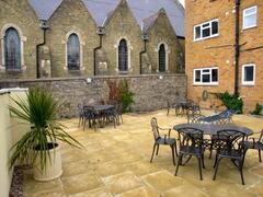 Property Photo: Rear patio area.