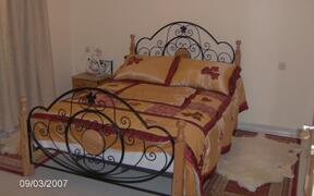 one of two doublebed sleeping rooms
