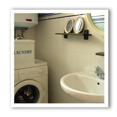 Laundry room with and Toilet and wash basin