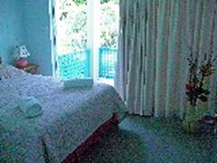 Queen bedroom overlooking resort swimming pool