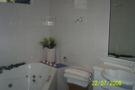 Bathroom with luxury spa bath in Cairns holiday house