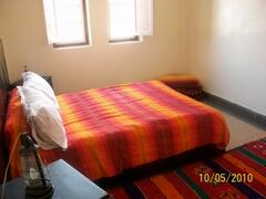 large bed room with 2 persons bed